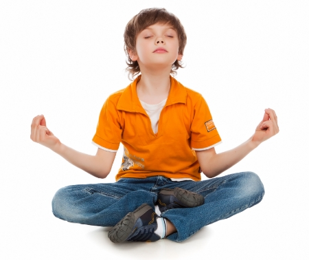 The little boy in a lotus pose meditates. Yoga - Kids ...